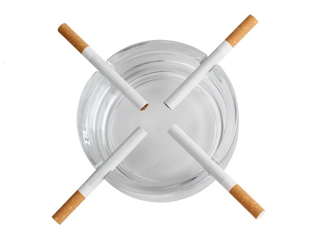 Color photo of a glass ashtray and cigarette photo