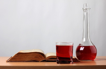 Color photo of a glass of wine and book photo