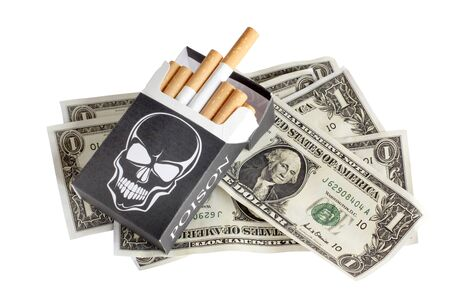 Color photo of a pack of cigarettes and money photo
