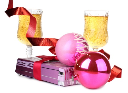 Color photo of Christmas toys and wineglasses photo