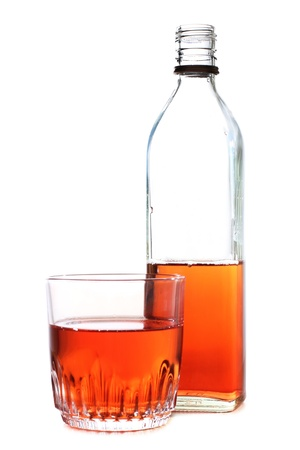 whisky bottle: Color photo of a glass of whiskey