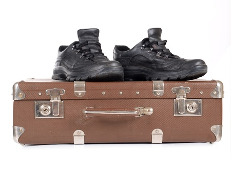Color photo of an old suitcase and mens shoes        photo