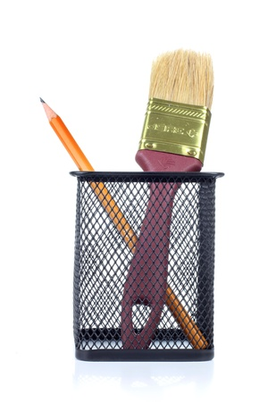 Color photo of brush in a metal cup photo