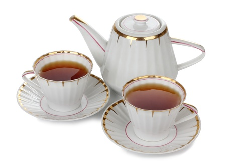crockery: Color photo of china cups of tea