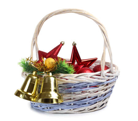 Color photo of bells in wooden wicker basket photo