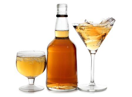 whisky bottle: Color photograph of glasses of whiskey with ice Stock Photo