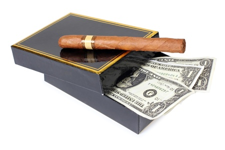 Color photo of an expensive cigar and paper money photo