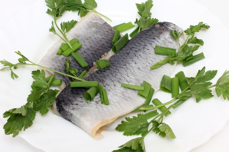 color photographs: Color photographs of salt herring on a plate