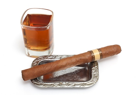 Color photo of a glass of cognac and a big cigar photo