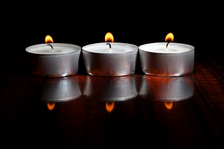 Color photo of candles on a wooden table Stock Photo - 16594401