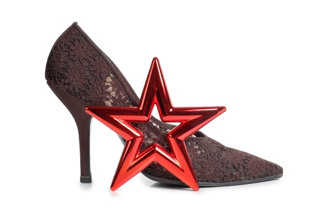 cinderella shoes: Color photograph of women s shoes and a red star Stock Photo