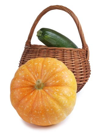 large pumpkin: Color photo of a large pumpkin and a wicker basket         Stock Photo