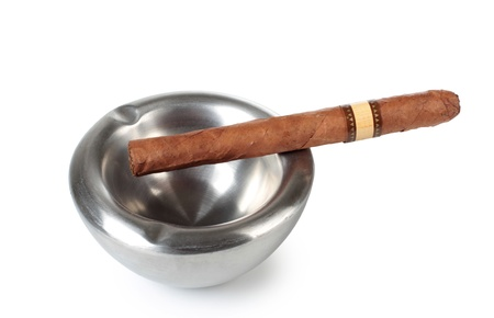 smuggling: Color photo of a large cigar in a metal ashtray
