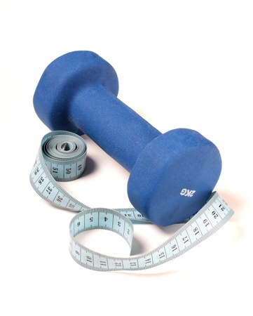 Color photo of sports dumbbells and a ruler on a white background Stock Photo - 18652824