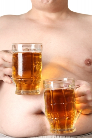 Color photo of a large belly and a mug of beer photo