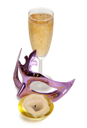 Theatrical mask and champagne glass on a white background photo