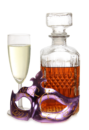 Theatrical mask and whiskey glass on white background photo