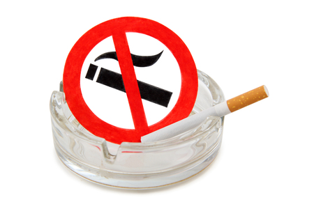 Sign and glass ashtray on a white background photo