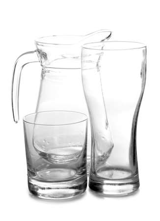 Empty glass pitcher on white table photo