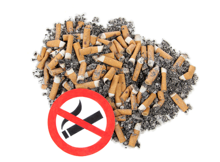 killing cancer: Sign on butts of cigarette on a white background Stock Photo