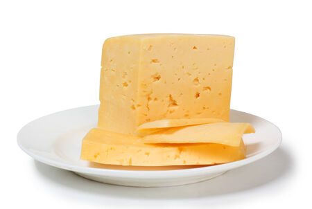 cheez: Yellow cheese on a plate on white background