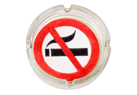 killing cancer: Sign and ashtray on a white background