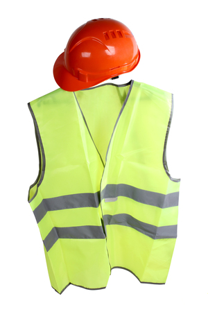 Construction hard hat and high visibility vest on a white background photo
