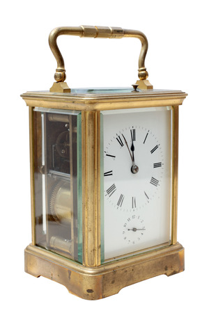 Vintage bronze clock on a white background photo