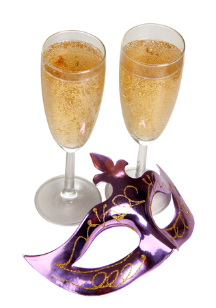 silver flute: Theatrical mask and champagne glass on a white background