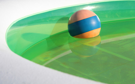 rubber ball: Colorful rubber ball in an inflatable pool