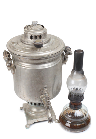 traditionally russian: Vintage metal samovar on a white background