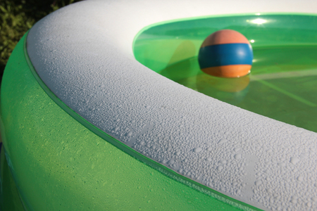 furlough: Colorful rubber ball in an inflatable pool
