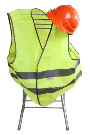 protective work wear: Construction hard hat and high visibility vest on a white background Stock Photo