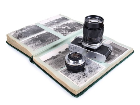 viewfinder vintage: Vintage camera at the old photos on white background