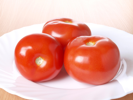 Tomatoes and peppers on white plate