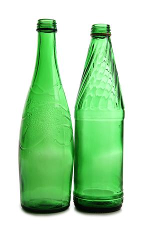 bottleneck: Green bottles and glasses on a white background Stock Photo