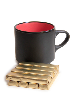 Coffee cup and chocolate on white background
