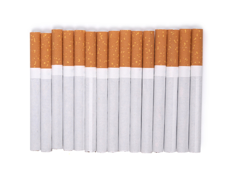 pernicious habit: Filter cigarettes on white background