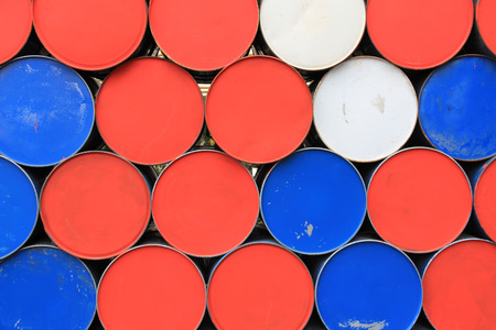 brent: Large metal barrels stacked in a row Stock Photo