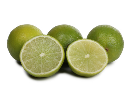 jello: Green lemon fruits on a white background Stock Photo