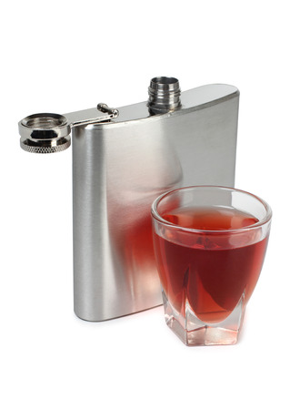 Metal flask and a glass on a white background Stock Photo