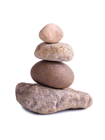 Stack of old stones on a white background