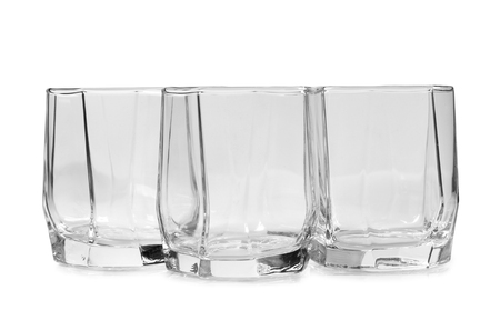 glass jars: Glass jars with whiskey and ice on white background Stock Photo