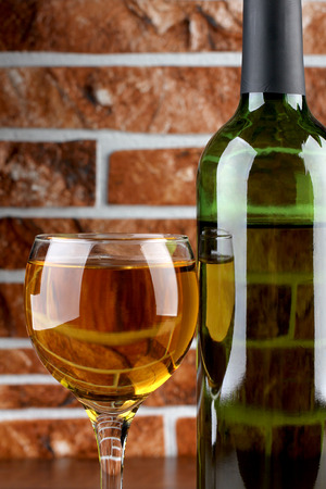 Glass and bottle wine on wooden table