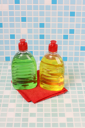 veneno frasco: Protective and cleaning products on tile background Foto de archivo