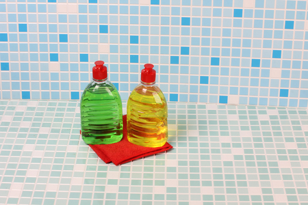 Protective and cleaning products on tile background Stock Photo