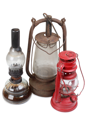 Old kerosene lamps on white background Stock Photo
