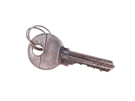 Metal key for padlock on white background