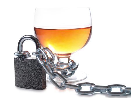 Wineglass of whiskey and metal chain Stock Photo
