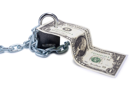 lock symbol: Several paper dollars and padlock on white background Stock Photo